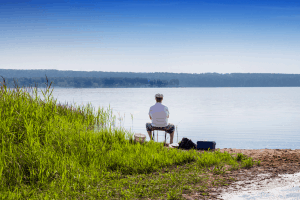 Man sitting down and summer fishing