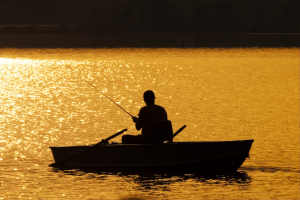 Picture of a man fishing from a boat