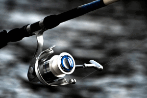 Fishing Reel with water in the background