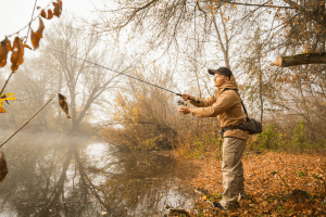 Fisherman with spinning on the river bank