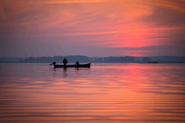 Two fishermen on a boat