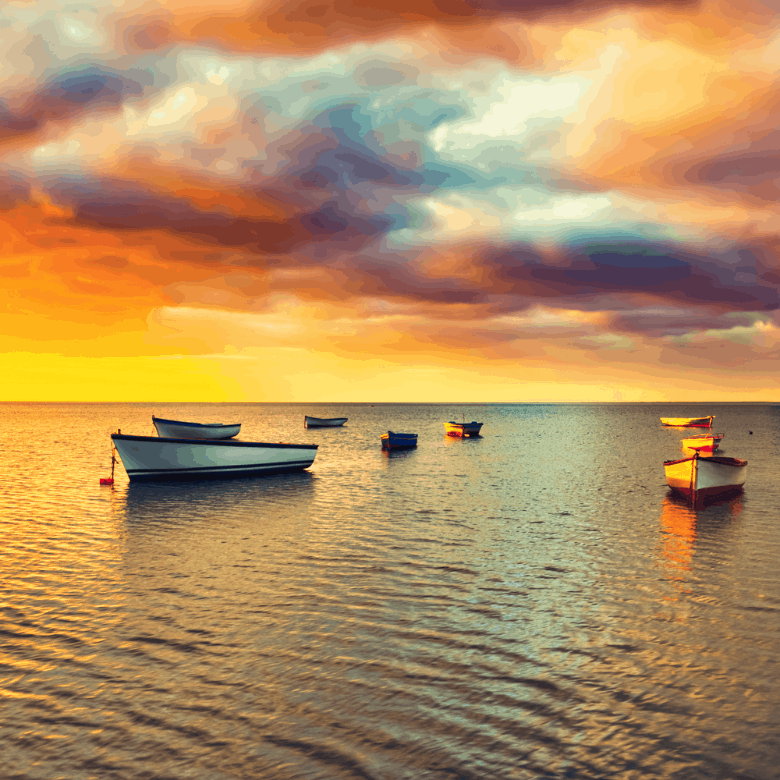 Fishing boat at sunset time